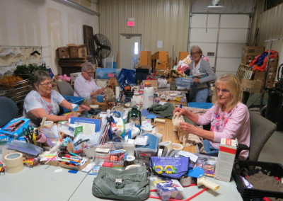 volunteers sorting and cleaning thrift store donations